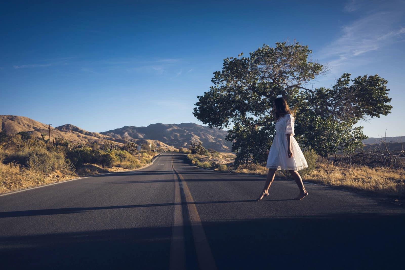 Girl walking across road